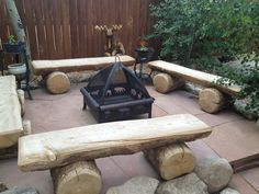 Fire ring, custom log benches and carved moose in back to the right.