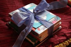 Sister gift- This is the easiest way to get a gift. What you need is one book or more if you prefer and wrap them all with a ribbon or a lace.