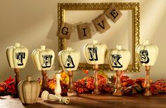 Wooden candle sticks, paper mache pumpkins and vinyl lettering come together to create an unexpected and delightful fall tablescape! Directions at Craft Warehouse's blog.