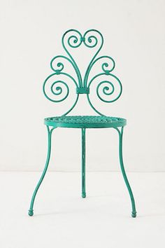 A garden chair of colorful flourishes, inspired by the designs of traditional wrought iron fencing. By British designer and artist David Le Versha.