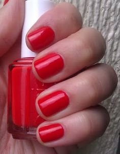 Essie Geranium... go-to nail shade, i love anything red (my favorite color) with a hint of orange. Classic with an edge.