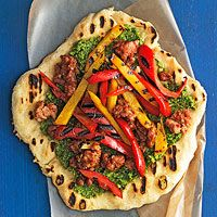 Hot Sausage & Sweet Pepper Pizzas with Almond Pesto   http://www.rachaelraymag.com/recipe/hot-sausage-sweet-pepper-pizzas-with-almond-pesto/