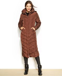 Steve Madden Hooded Maxi Puffer  Steve Madden's maxi-length puffer coat boasts enough style to rival even your most stunning outfit!      Polyester; lining: polyester; fill: polyester     Machine washable     Imported     Removable zip-off hood     Pillow collar     Zipper closure with snap overlay at front     Tonal colorblocking at hood     Chervron-pattern quilting; smocked panel at back waist     Polyester fill     Lined     Heavy weight     Hits at mid-calf; approx. 48 inches