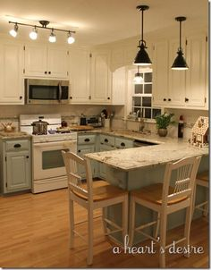 Kitchen redo with two tone cabinets in blue and cream, black hardware