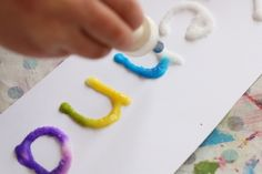 dripping watercolours onto letters traced with glue and salt