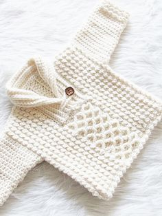 This crochet baby boy sweater features a beautiful mix of 2 textured stitches and a sylish shawl collar. Try making one - SalvabraniRavelry: Bentley Sweater pattern by CrochetDreamzKeep you new bundle of joy luke-warm along with a unisex vest. Crochet Baby Clothes Boy, Crochet Baby Jacket, Crochet Baby Sweaters, Baby Boy Knitting, Crochet Toddler, Crochet For Boys, Crochet Baby Booties, Baby Knitting Patterns, Baby Patterns