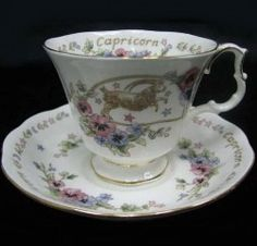 Royal Albert - Capricorn  1987 to 1987  Practical, Economical, Persevering, Dec 22nd to Jan 20th  Cup Shape: Gainsborough  Series of 12, Aquarius, Aries, Cancer, Capricorn, Gemini, Leo, Libra, Pisces, Sagittarius, Scorpio, Taurus, and Virgo