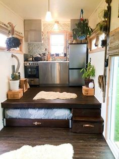 The bed slides under the kitchen riser!