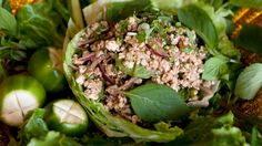 Larb gai is a dish of chopped chicken, mint, basil and red onions dressed with lime juice and ground red chilies (The dish is sometimes spelled laab, lob or lop.)