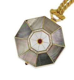 A diamond, ruby and mother-of-pearl compact
