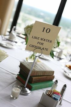 Tables named for love stories. Perfect!    http://boards.weddingbee.com/topic/library-themed-wedding-floral-ideas