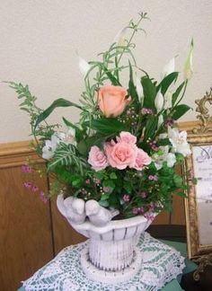 We did this arrangement for the Getz's wedding reception! This elegant bird bath planter is simply beautiful.
