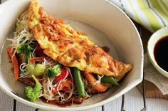 Asian vegetable and noodle omelettes...um not sure about this one(the outside looks much too crispy for My type of omelette, ) but still looks yummy