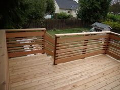 Deck railing varied width horizontal rails