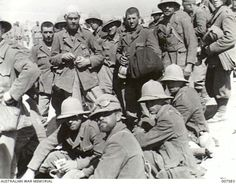 1941-04-25. TOBRUK. ITALIAN PRISONERS CAPTURED BY PATROLS OF AUSTRALIAN INFANTRY ROUND TOBRUK. (NEGATIVE BY F. HURLEY). Pin by Paolo Marzioli