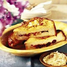 Stuffed French Toast Grand Marnier - -   Golden French toast stuffed with fresh banana slices and dried cherries and apricots makes a flavorful package that is wonderfully accented by orange-flavored butter. Alternatively, omit the butter and serve the French toast with a dusting of confectioners' sugar.  http://www.williams-sonoma.com/recipe/stuffed-french-toast-grand-marnier.html?cm_src=RECIPESEARCH