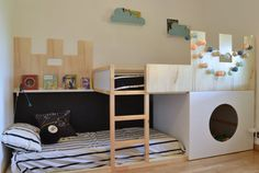 Cute twin kids bedroom, with bunk beds and play areas. Could be for boys or girls