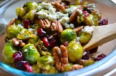 Pan-Seared Brussels Sprouts with Cranberries & Pecans Mitzi's Modification: Use honey instead of maple syrup. #client