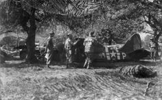 Soldiers in the Ghost Army check an inflatable L4 plane.