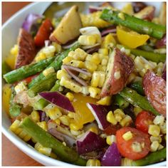 This Roasted Vegetable Salad with Lemon Vinaigrette combines roasted potatoes, corn and asparagus tossed in a fresh lightly sweetened lemon vinaigrette.