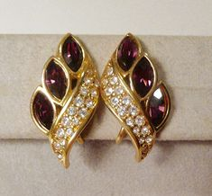 Vintage S.A.L. Swarovski Clip On Gold Tone Metal With Purple
