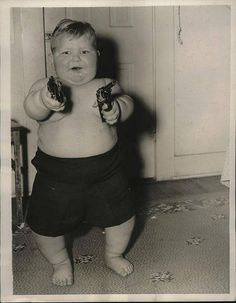 Oh, just a giant baby with two pistols.