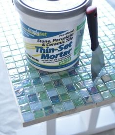 thin set mortar DIY mosaic outdoor table for the diy table and chairs I just got that needs a top. by Manueeltje