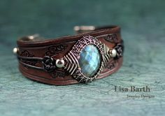 Beautiful Labradorite cab in a sterling, hand woven bezel and hand made leather bracelet to go with it.  -Lisa Barth