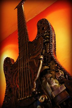 Guitar sculpture made with recycled metals at Desires Bar.