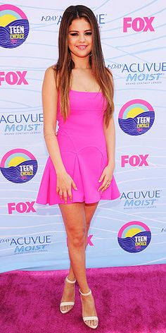 Birthday girl Selena brightens the night (and matches the carpet!) in a hot pink A-line Dsquared2 mini, Lana Jewelry gems and white ankle-strap sandals.