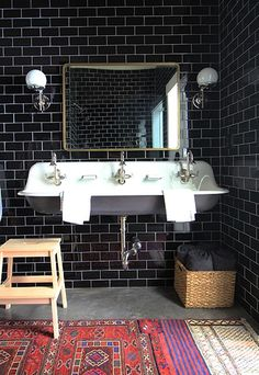 Black subway tile + a triple sink + round wall sconces | Juniper Studio