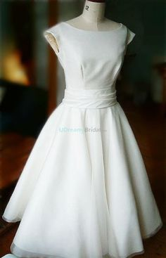 1950s vintage wedding dress with boat neckline and sleeveless design. Features ruched waist and gathered skirt. Made of satin and organza. Free made-to-measurement service for any size. Available colors seen as in Color Options.