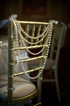 Pearls as chair decorations - so elegant #weddingdecor #diywedding #gold