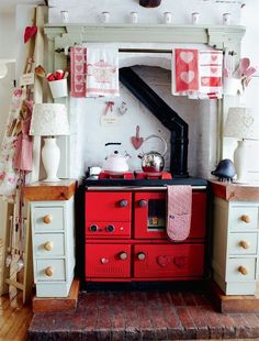 tiny, retro kitchen in red and white. Love how cozy this looks. 17 Retro Kitchen Designs To Inspire You Red Cottage, Cottage Living, Cottage Style, Cozy Cottage, Red Kitchen, Country Kitchen, Vintage Kitchen, Kitchen Stove, Cozy Kitchen