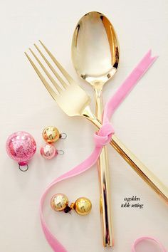 Shiny gold flatware with pink for a pretty little party