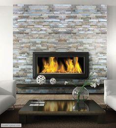 Fireplace inspiration. Ledgestone wall, floating mantel under wall mounted fireplace.