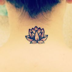 New small lotus neck tattoo. Red signifies love and compassion