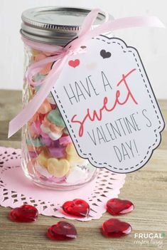 These low-cost Valentine's Day Gift Ideas are not only frugal but incredibly easy. Using conversation hearts, create a Mason Jar Valentines with a printable Valentine Gift Tag. Print your Valentine gift tags with a printer or using Cricut Design Space and your Cricut machine. As a bonus, take a look at other creative Valentine Cricut Ideas to create your very own DIY Valentine Gifts. #FrugalCouponLiving #Cricutmade #valentinesdaygiftideas #valentinegifttag #masonjarvalentines #masonjargifts