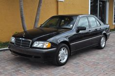 1997 Mercedes C230. Black on black - great car, just too sedate pour moi.