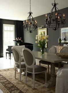 Gray dinning room, love the light fixtures!