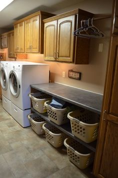 We recently redid our laundry room. It was an add on to the house along with a garage. The cubbies have been great. Each one has its own plug in so the kids can charge ipods, phones, etc. The sorting baskets and hanging rod have been even better than I imagined.