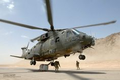 A Royal Air Force Merlin helicopter takes off with an underslung load in Afghanistan. #OEF #Afghanistanwar