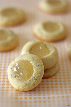 These Lemon Poppy Seed Thumbprints are soft, buttery cookies filled with poppy seeds and a dollop of lemon curd. Yummy Treats, Sweet Treats, Buttery Cookies, Thumbprint Cookies, Cupcakes, Spring Recipes, Lemon Curd, Just Desserts, Cookies Et Biscuits