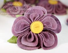 purple circles--Each petal is a layer of the three smaller circl sizes folded up, tacked together with a needle and thread. Then each petal was hot glued onto a circle.