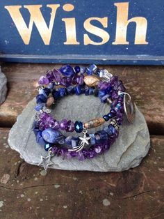Never Stop Making Wishes: three wrap memory wire beaded bracelet with metal stamped charm on Etsy, $30.00