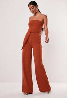 a wide leg jumpsuit featuring in a bandeau style with self buckle belted waist. regular fit Wide leg with heels - Sits just off the floor in heels Polyester Elastane jamilla wears a UK size 8 / EU size 36 / US size 4 and her height is Casual Formal Dresses, Burnt Orange Dress, Strapless Romper, Jumpsuit Outfit, Autumn Fashion Casual, Bandeau, Jumpsuits For Women, Bridesmaid Dresses, Rompers