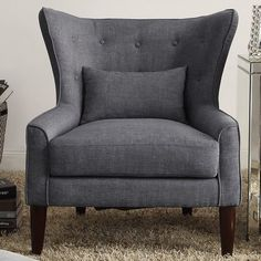 this classic beacon falls wingback chair adds a casual twist to your living room with its