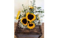 sunflower and baby's breath wedding bouquet arrangement