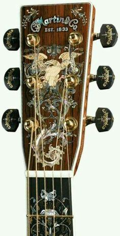 """Larry Robinson's inlay in the headstock and fingerboard of the millionth Martin guitar. Courtesy C. Martin and Co., """"Found my Martin Had to do it this way cause your pins won't pin? Guitar Pics, Guitar Art, Music Guitar, Cool Guitar, Playing Guitar, Martin Guitars, Ukulele, Guitar Inlay, Guitar Collection"""