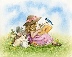 little girl reading to the animals